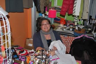 Sarah Hayden, owner of West Village Clothing Co., finishes up a sale.