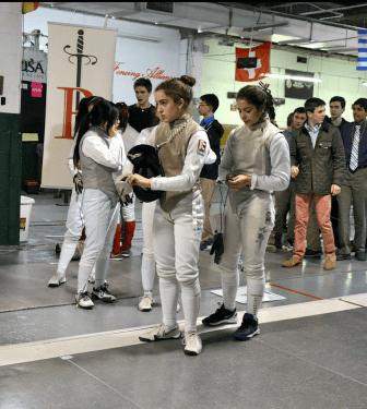 Marissa Viqueira (l.) gets a helping hand from sister Sam at the Bernards meet (credit Ben Garrison)