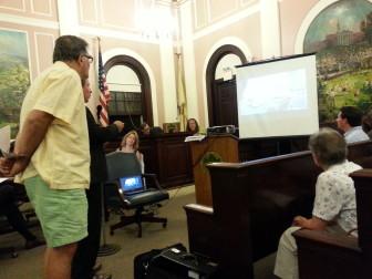 John Harvey questioning the architect David Minno.